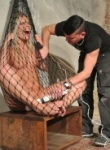 excitied slave caught in a net and abused with a magic wand and she is loving being a submissiv slut