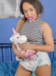 Kayla louise teases in her diaper while sucking on a dummy