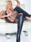 Lucy zara loves teasing her long legs in a tight latex dress watch as her knickers slowly glide down her legs